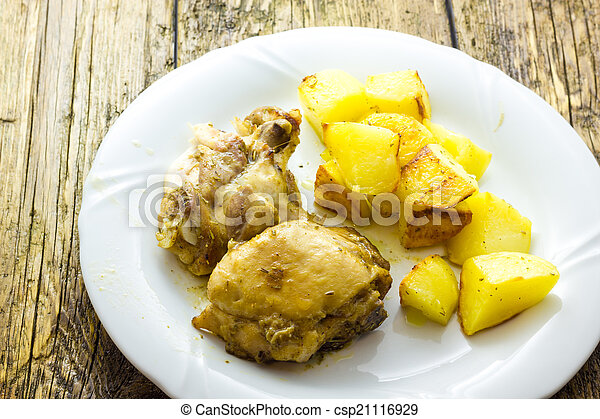 Chicken with potatoes - csp21116929