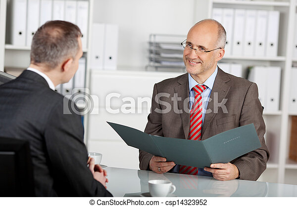 Chief of staff reviewing information of applicant - csp14323952