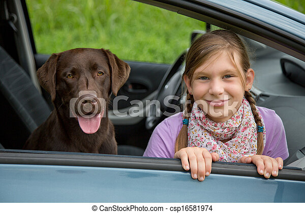 Child and dog in a car - csp16581974