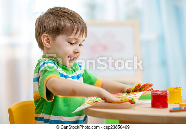 child boy painting at home - csp23850469