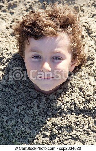 Child buried in the sand - csp2834020