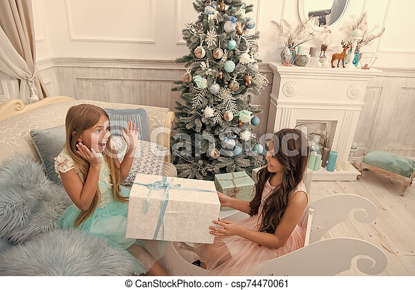 Child enjoy the holiday. The morning before Xmas. Little girls. Christmas tree and presents. Happy new year. Winter. xmas online shopping. Family holiday. Unexpected surprise - csp74470061