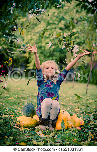 child enjoying autumn time in garden - csp51031361