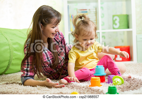 child girl and her mother playing together with toys - csp21988557