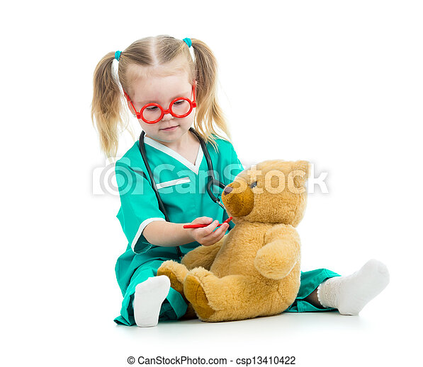 child girl dressed as doctor playing with toy - csp13410422