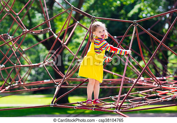 child having fun on school yard playground active little child