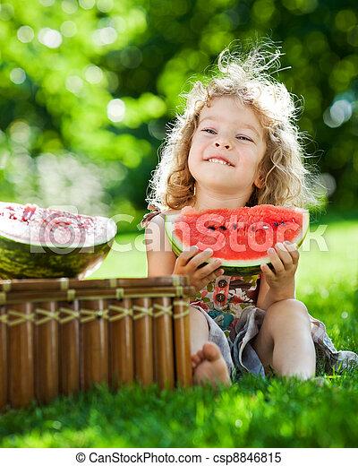 Child having picnic in spring park - csp8846815