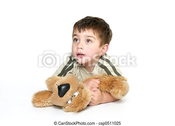 Child holding a plush toy - csp0511025
