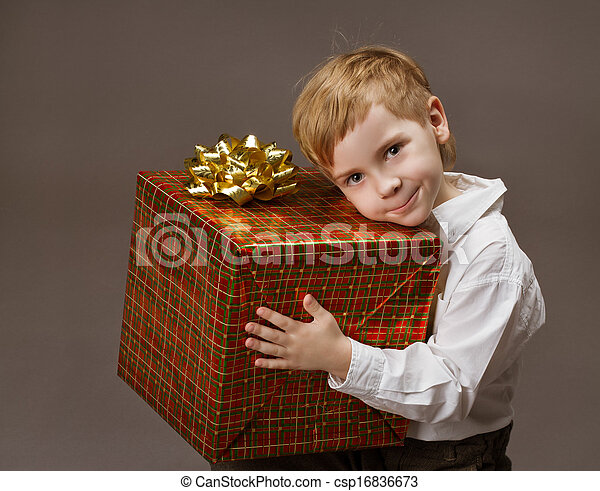 Child holding gift box. Boy with present - csp16836673