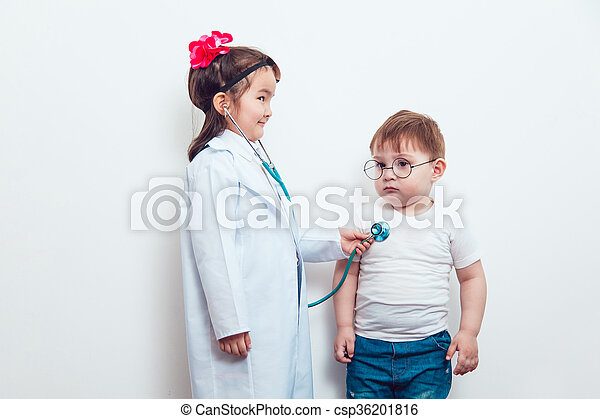 Child in a suit of the doctor with patient - csp36201816