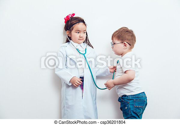 Child in a suit of the doctor with patient - csp36201804