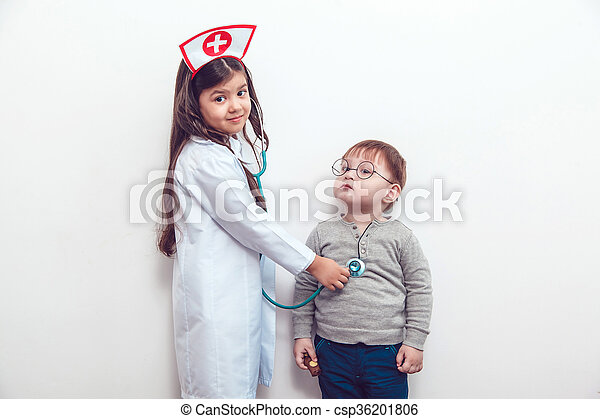 Child in a suit of the doctor with patient - csp36201806