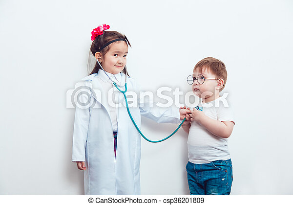 Child in a suit of the doctor with patient - csp36201809