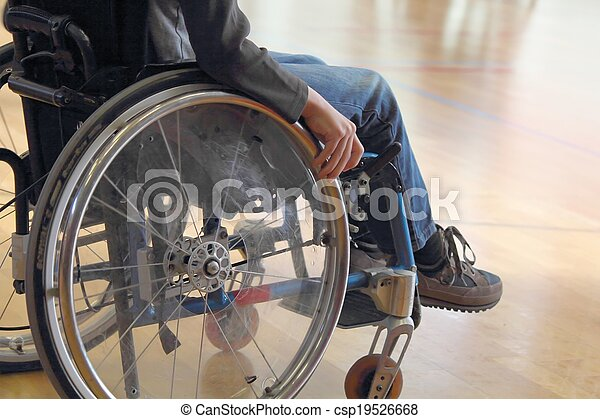 Child in a wheelchair in a gym - csp19526668