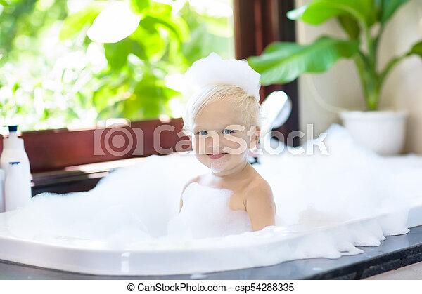 Child in bubble bath. kid bathing. baby in shower. Little child ...