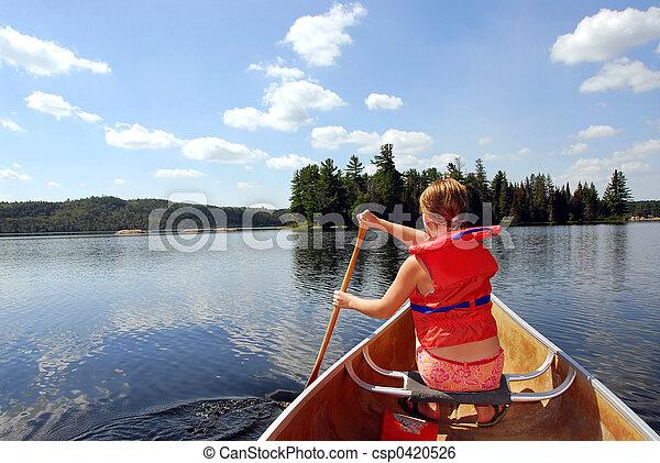 Child in canoe - csp0420526