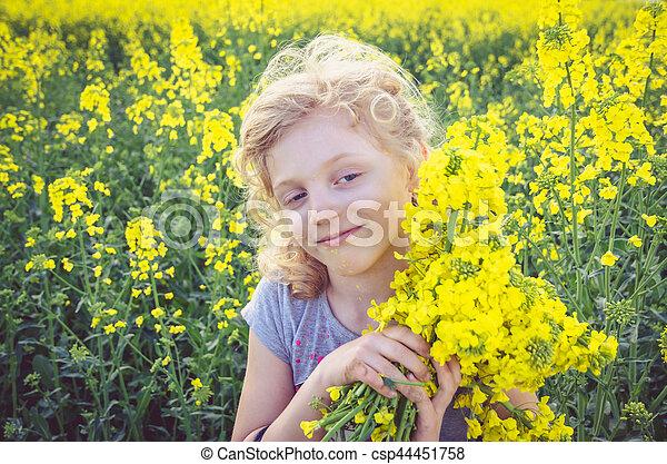 child in field - csp44451758