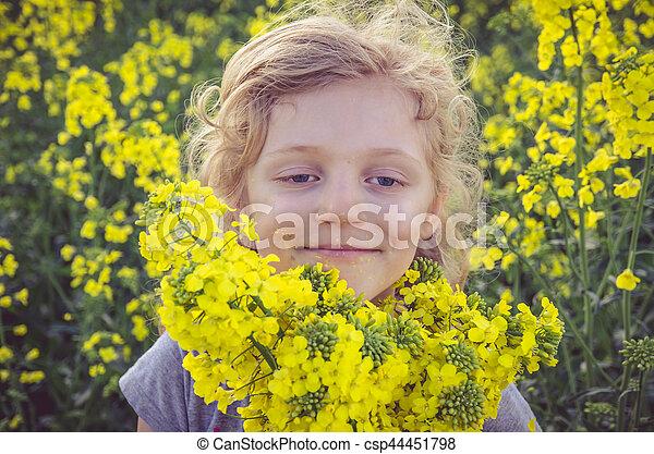 child in field - csp44451798