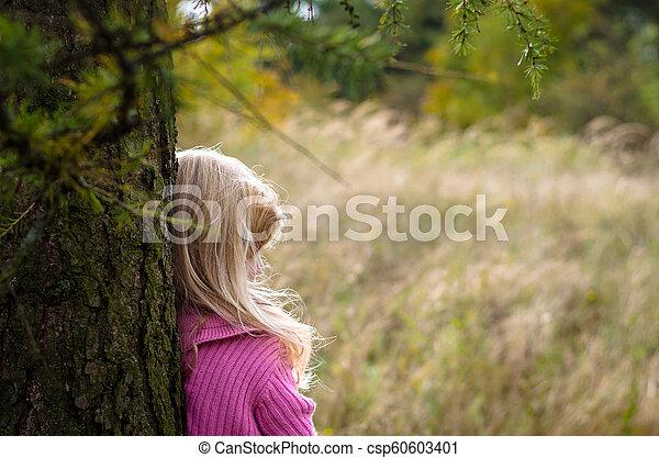 child in forest alone - csp60603401