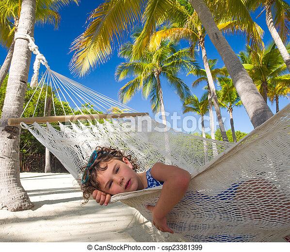 Child in hammock on vacation - csp23381399