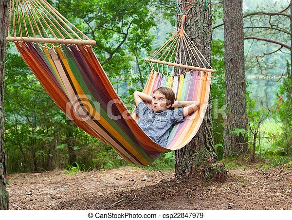 Child in hammock outdoors - csp22847979