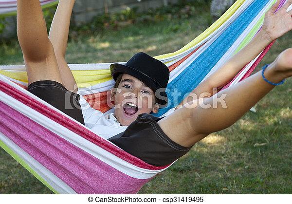 child in hammock smiling joy - csp31419495
