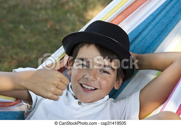 child in hammock smiling joy - csp31419505