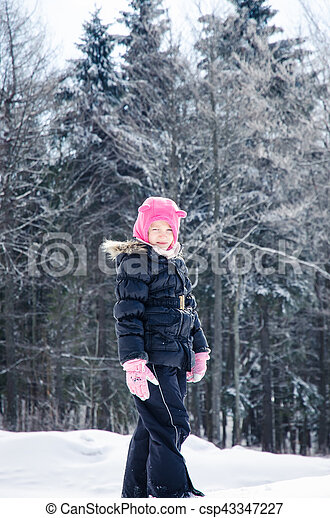child in snowy forest - csp43347227