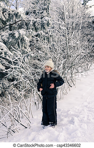 child in snowy forest - csp43346602