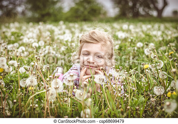 child in spring meadow - csp68699479