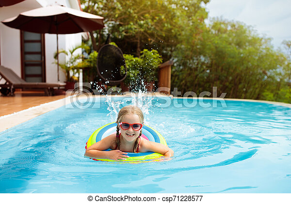 Child in swimming pool. Kids swim. Water play. - csp71228577