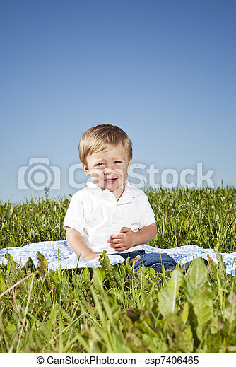 Child in the grass - csp7406465