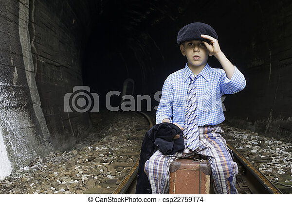 Child in vintage clothes sits on railway road - csp22759174