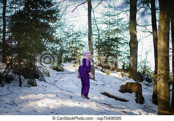 child in winter forest - csp75408395