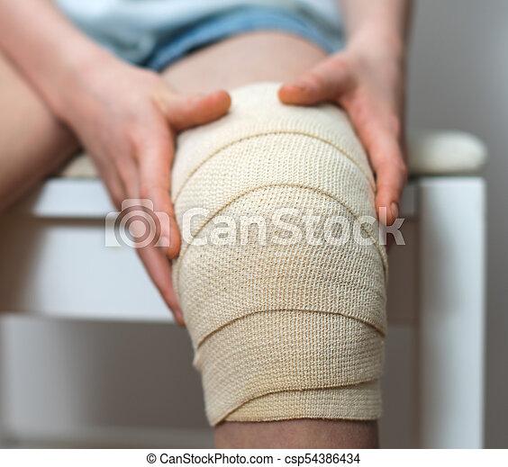 Child Knee With Elastic Bandage On It