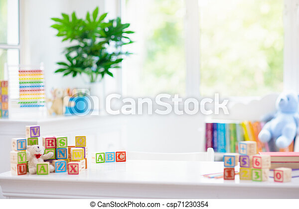 Child learning letters. Kid with wooden abc blocks - csp71230354