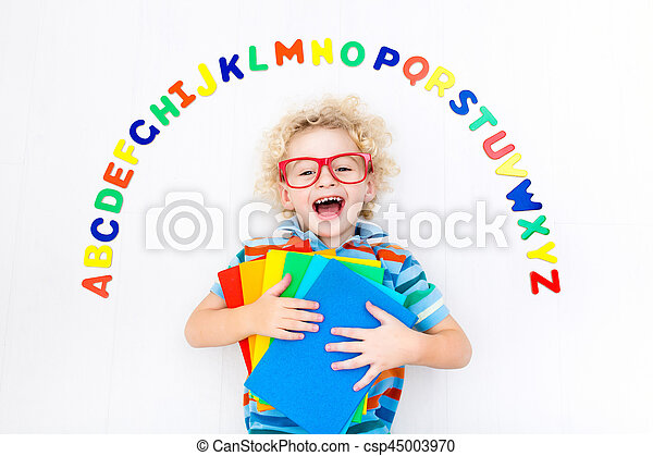 Child learning letters of alphabet and reading - csp45003970