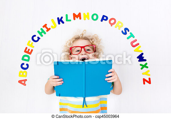 Child learning letters of alphabet and reading - csp45003964