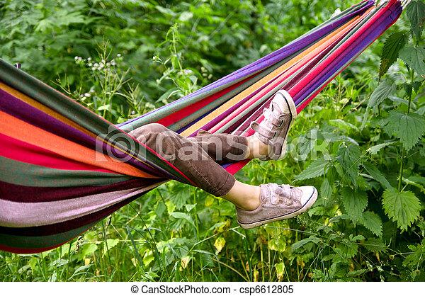 child lying in a hammock - csp6612805