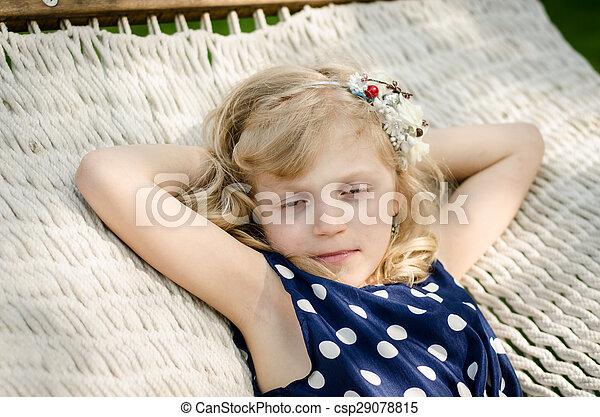 child lying in hammock - csp29078815