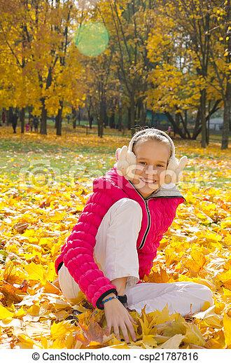 Child on leaves - csp21787816
