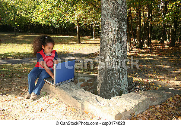 Child Outside with Laptop - csp0174828