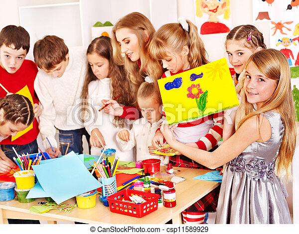 Child painting at art school. - csp11589929
