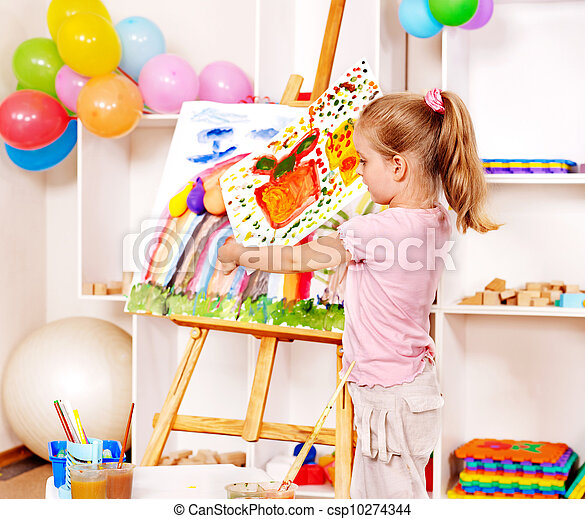 Child painting at easel. - csp10274344