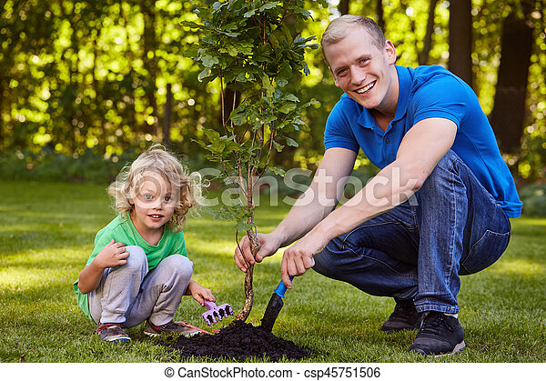 Child planting tree seedling - csp45751506
