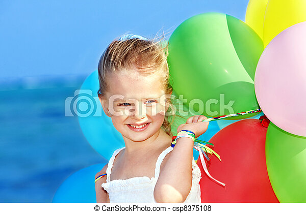 Child playing with balloons . - csp8375108