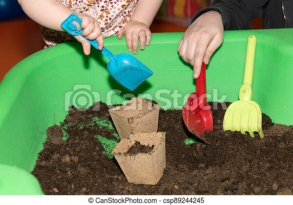 Child playing with dirt - csp89244245