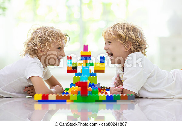 Child playing with toy blocks. Kids play. - csp80241867
