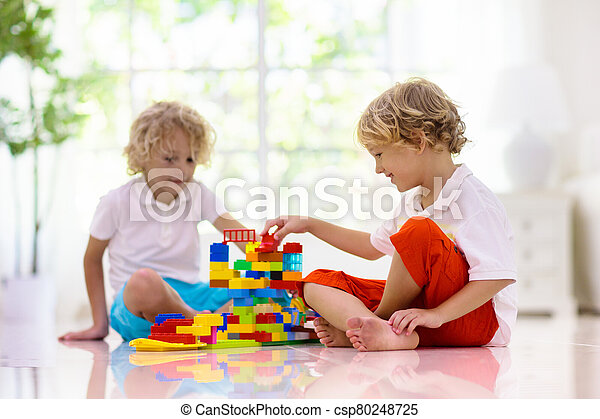 Child playing with toy blocks. Kids play. - csp80248725