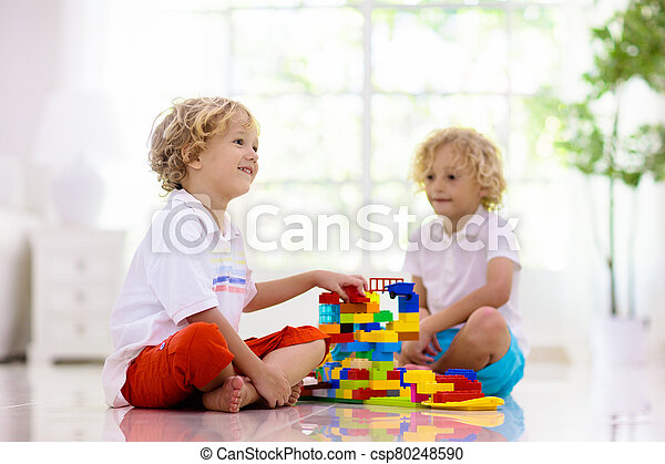 Child playing with toy blocks. Kids play. - csp80248590